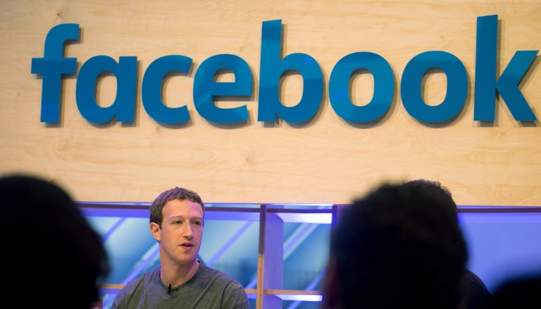 "Facebook founder and chief Mark Zuckerberg speaks at the so-called ""Facebook Innovation Hub"" in Berlin on February 25, 2016. Facebook announced it was donating computer servers to a number of research institutions across Europe, starting with Germany, to accelerate research efforts in artificial intelligence (AI) and machine learning. / AFP PHOTO / dpa / Kay Nietfeld / Germany OUT"